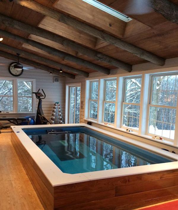 Square-pool-beside-many-windows