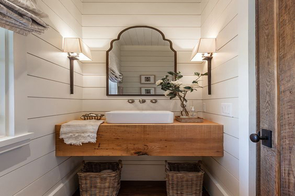 Framehouse-bathrooom-with-beautiful-lamps-placed-between-the-mirror copy