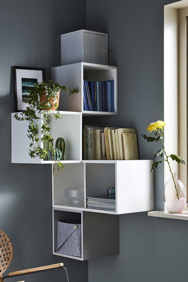 Laying-down-a-bookcase-in-the-corner-of-the-room