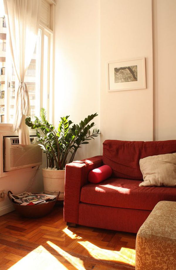 White-living-room-theme-with-red-sofa
