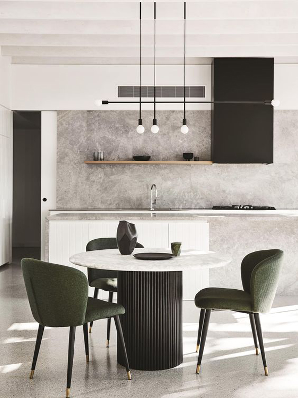 A-round-dining-table-and-black-dining-chairs