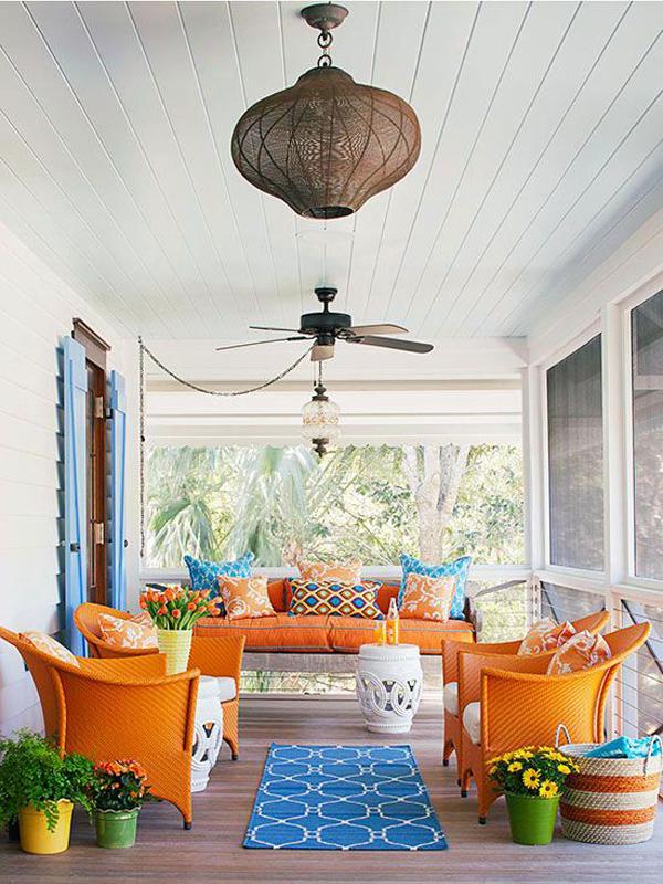 Front-decor-with-orange-sofa-and-blue-carpet